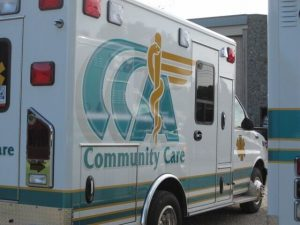 Sideways parked Community Care Ambulance