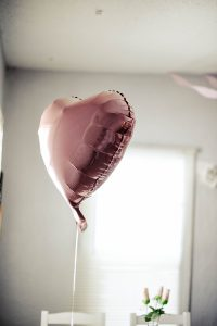 Pink heart balloon floating in the air
